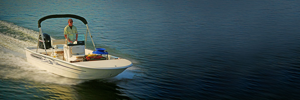 Man in Surf City on Topsail Boat Rental 17 Foot Center Console Triumph Skiff image