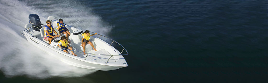 Family in Surf City on Topsail Boat Rental 17 Foot Dual Console Triumph Boat image